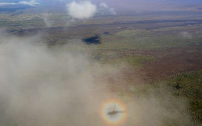 solar_glory_with_helicopter_shadow_around_mauna_loa
